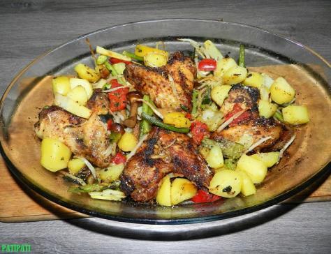 Ailes de poulet aux epices et legumes
